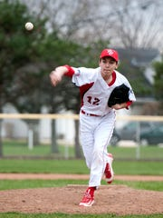Port Clinton's Trevor Frias pitches during the Redskins home game versus the Bellevue Redmen on Wednesday evening.