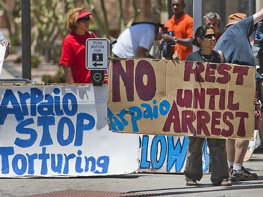 Protesters gather outside Arpaio's office on June 25, 2012, after the U.S. Supreme Court upheld one provision of Senate Bill 1070 and struck down three others as unconstitutional.