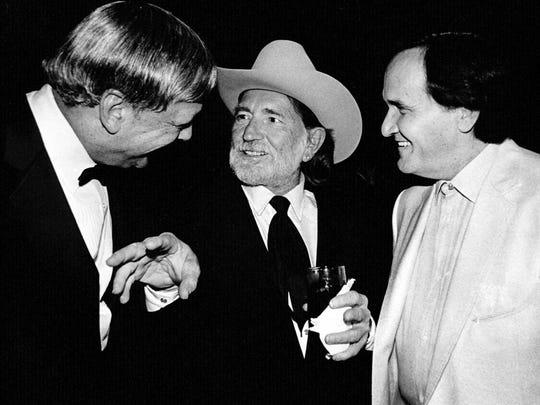Fred Foster, left, Willie Nelson and Roger Miller share