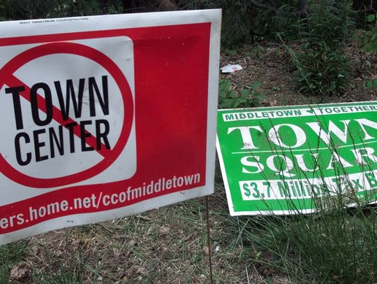 Signs opposed to a proposed town center development