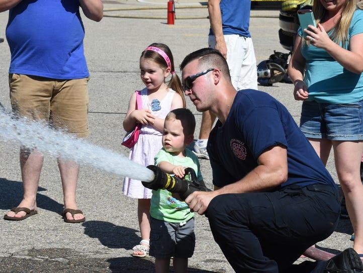 Future firefighter Joseph Zomberg (center) of Farmington