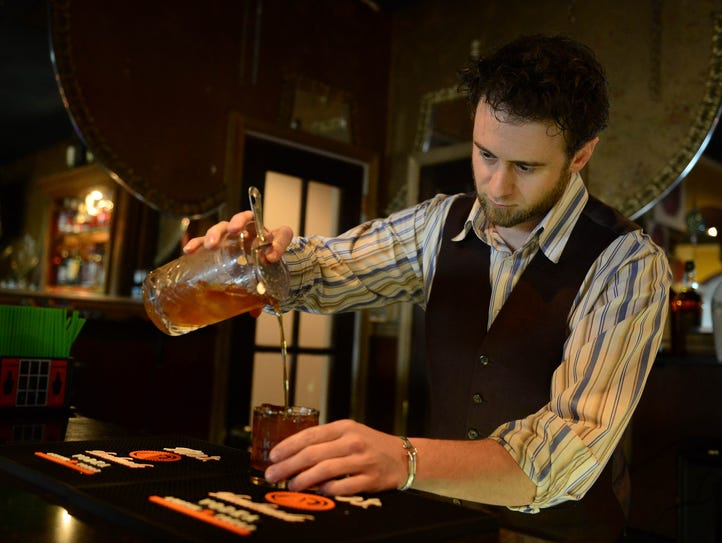 Ocean 13's Mixologist Tim Coiner Williams prepares