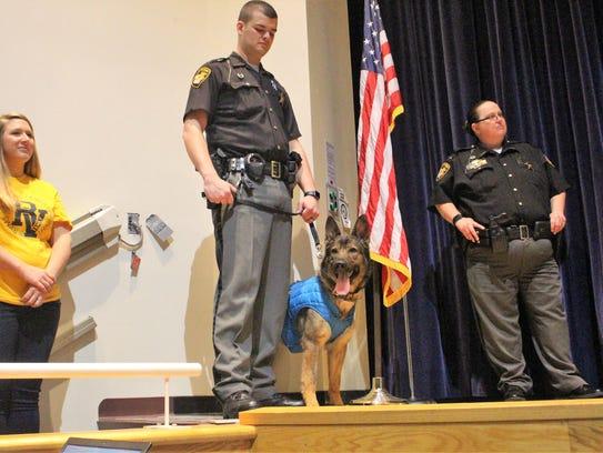 K-9 deputy Viking stands next to her handler Lt. Corey