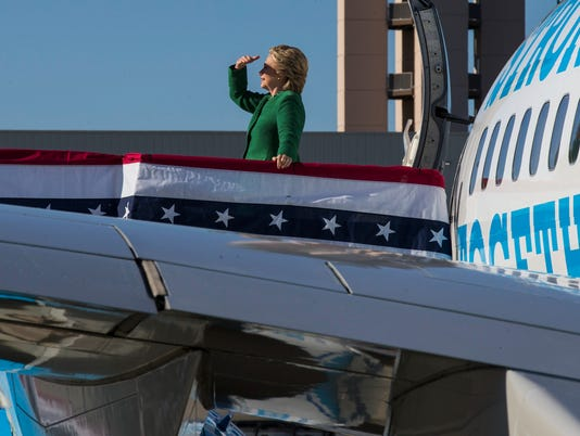 Hillary Clinton looks back before boarding her campaign plane after a rally in Raleigh.