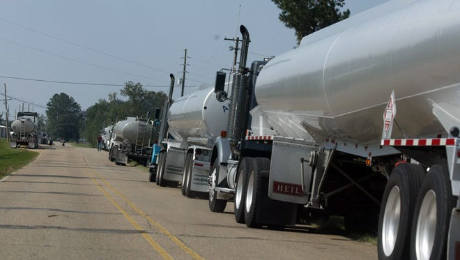 Tanker trucks wait in line to enter one of the gas terminals in Collins, a distribution hub for two major gasoline pipelines.