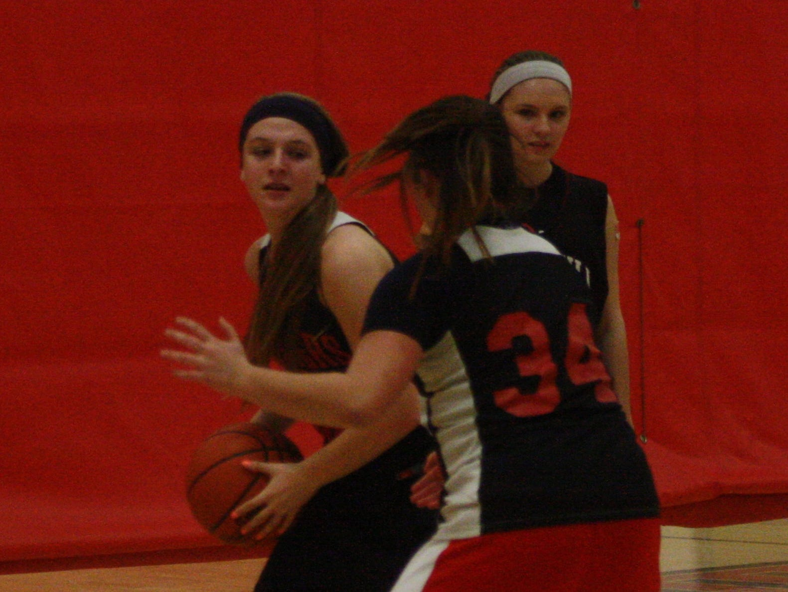 Churchill's Payton Byron is guarded by Alivia Kondrath during a Monday afternoon practice drill.