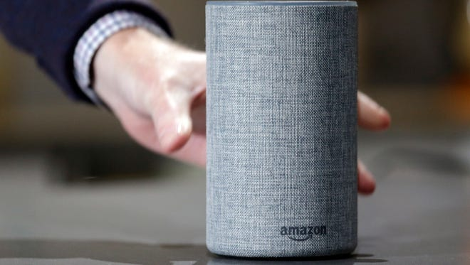 The new Amazon Echo is on display on Sept. 27, 2017, in Seattle. Beginning this summer, Amazon will make a new version of the Echo available to some Marriott International hotels.