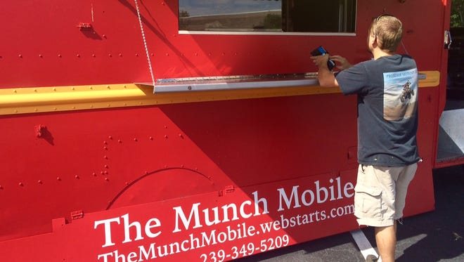 The first customer of the day orders a steak quesadilla at The Munch Mobile last week.