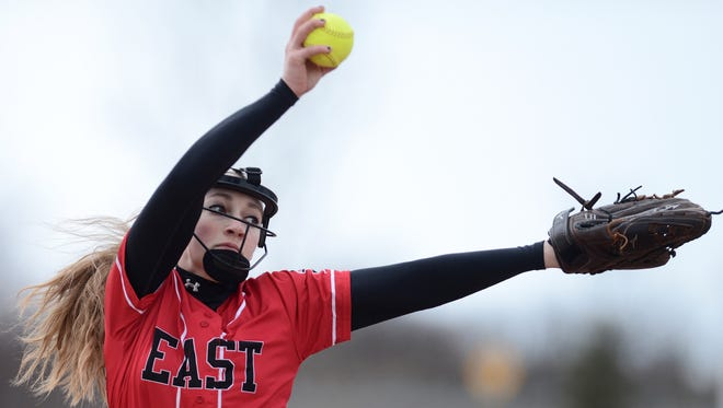 Green Bay East's Jaida Reynen delivers a pitch in the first inning. Green Bay East's Green Bay East played Green Bay Southwest at Parkway Riverview Park in Allouez, Wis. on Tuesday, April 7, 2015. Kyle Bursaw/Press-Gazette Media/@kbursaw