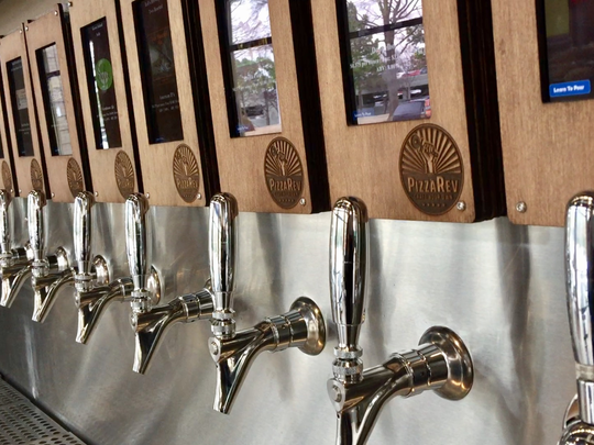 PizzaRev lets customers 21 or older pour their own beer from taps.