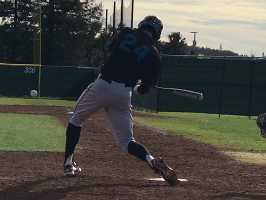 Carson McCusker bats in a recent game at Folsom JC.