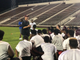 Pensacola High head coach Mike Mincy (standing, left)