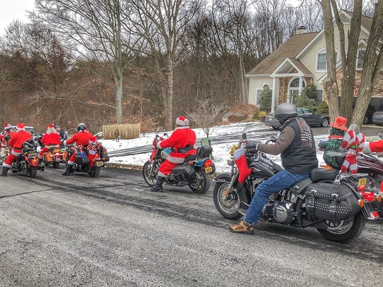 Several motorcycle Santas cruised around Wanaque on Dec. 17, 2017 visiting with residents and giving out candy canes.