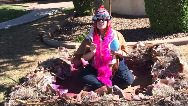 Alexa Castro, of Phoenix, built a giant bird's nest and perched in front of a home in an upscale neighborhood as part of the Greatest International Scavenger Hunt the World Has Ever Seen.