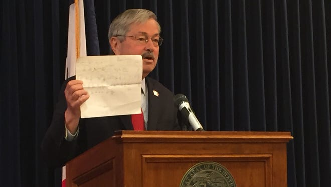 Iowa Gov. Terry Branstad displays a hand-drawn family tree he said his second-cousin Merrick Garland gave him when they met in February. President Barack Obama has nominated Garland to the U.S. Supreme Court.