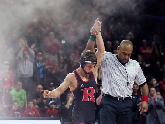 Rutgers' Nick Suriano pins Penn State's Devin Schnupp in their 126-pound bout.