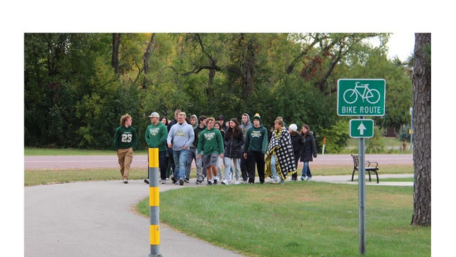St. Mary's senior class led the way around the lake.