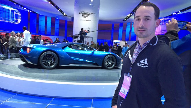 Ted Serbinski, Managing Director of Techstars Mobility, in Detroit. In the background is the Ford GT supercar that is on display at Cobo Center during the 2015 North American International Auto Show on Jan. 15, 2015.