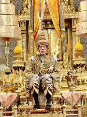 In this photo released by Bureau of the Royal Household, Thailand's King Maha Vajiralongkorn sits on the throne in front of an audience of diplomats and dignitaries after being officially crowned king at the Grand Palace, Saturday, May 4, 2019, in Bangkok, Thailand.