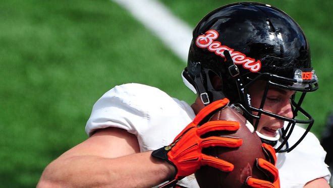 Oregon State tight end Caleb Smith catches the ball during practice inside Reser Stadium, on Saturday, April 4, 2015, in Corvallis.