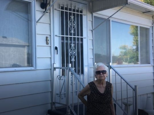 Dorothy Funk outside her manufactured home at Western Village.