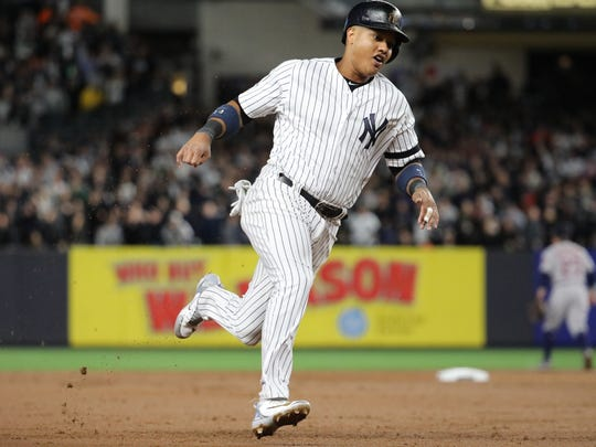Starlin Castro gets ready to round third base after Todd Frazier hit a three-run  home run in the second inning of Game 3, Monday, October 16, 2017.