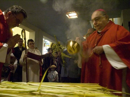 Bishop Joseph A. Galante blesses the palms at the start of Palm Sunday mass at Cathedral of the Immaculate Conception in Camden on  March 16, 2008.