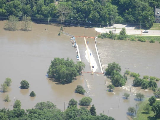 Floodwater from the Iowa River covers the Park Road bridge in Iowa City on Monday, June 16, 2008.
