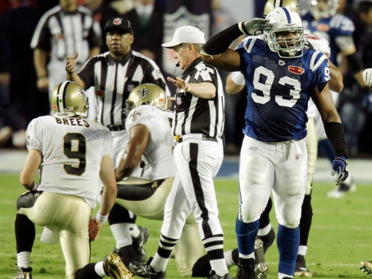 ADVANCE FOR WEEKEND EDITIONS, FEB 4-5 - FILE - In this Feb. 7, 2010, file photo, Indianapolis Colts defensive end Dwight Freeney (93) celebrates during the first half of the NFL Super Bowl XLIV football game against the New Orleans Saints in Miami. New England has a bunch of young players, 16 with four years or fewer in the NFL, and the Falcons actually have four guys who have played in a Super Bowl: Dwight Freeney, Courtney Upshaw,  Dashon Goldson and Philip Wheeler. (AP Photo/Chuck Burton, File)