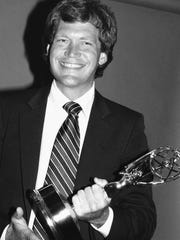 David Letterman clutches the Emmy he was awarded in 1981 as television's top variety show host.