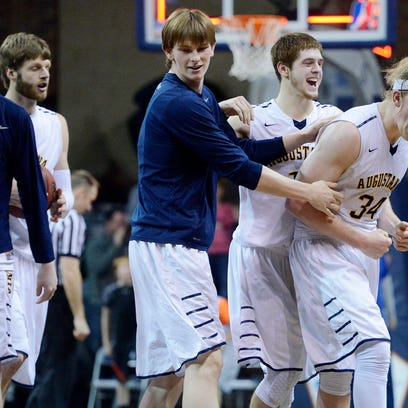 Augie's Daniel Jansen and his teammates celebrate after beating Northern 67-65 in overtime in Monday's NSIC semifinal game Monday night.