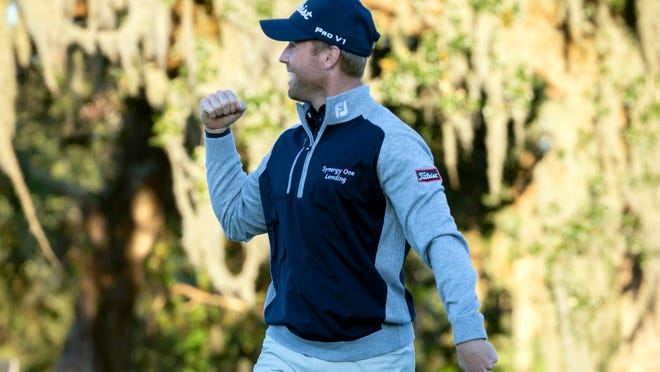 Tyler Duncan pumps his fist after beating Webb Simpson in a playoff at the 2019 RSM Classic.