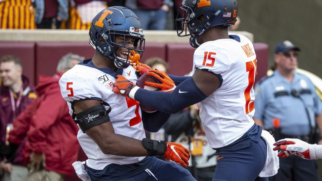 Illinois linebacker Milo Eifler (5) celebrates with defensive back Delano Ware (15) his fumble by Minnesota and a touchdown return during a game last season in Minneapolis.