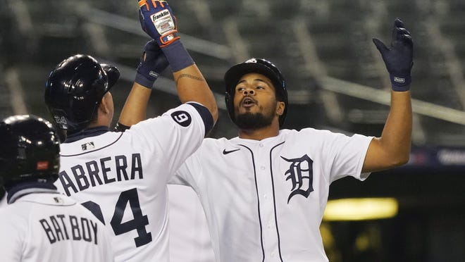 Detroit Tigers' Jeimer Candelario, right, celebrates with Miguel Cabrera after they scored on Candelario's two-run home run during the seventh inning of the team's baseball game against the Milwaukee Brewers, Tuesday, Sept. 8, 2020, in Detroit.