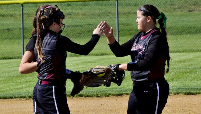 Alexis Strother, right, high-fives Kat Frank, left, for shutting the door in the first inning for Lebanon on May 8, 2017.