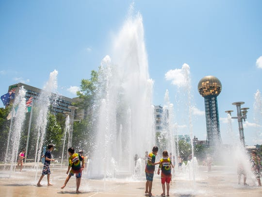 Children play in the fountains at World's Fair Park