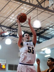 Wylie's Kyle Roberts (55) goes up for a shot during the Bulldogs' 91-43 win against Vernon in the Region I-4A bi-district playoff in Olney on Monday, Feb. 19, 2018.
