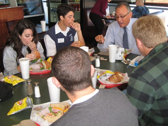 Denton Santarelli, who retired from his post as superintendent this spring, was a long-time fixture in the Peoria Unified School District. In this 2009 photo, Santarelli shares lunch with a group of students.