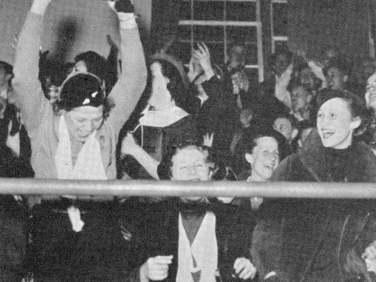 """The 1936 Technical High School annual wrote of these fans, """"This is what is known as school spirit. Here are Margaret Hendricks, Delores Schwinden, Jane Cary, Walburga Wiehoff, and Elaine Olson registering that bromidic thing called school spirit at the district tournament."""""""
