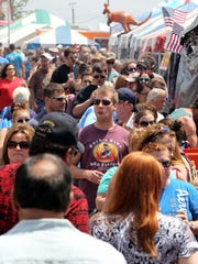 Rock'n Ribs is expected to bring 25,000 to 30,000 people to the fairgrounds Friday night and Saturday.