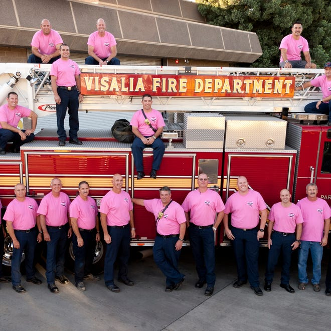Visalia Fire Department administration and firefighters from C shift pose for a picture at Station 51.  Members of the Visalia Fire Department will be wearing the pink shirts, on duty, for the entire month of October.