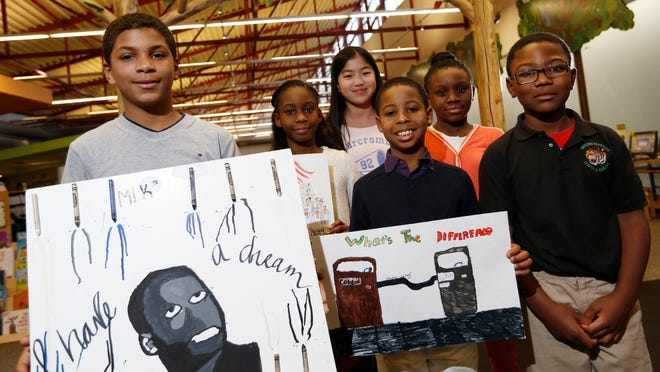 From left, Sean Head, 12, Raechel Gradford, 11, Samantha Harris, 12, Jeremy Gradford, 10, Destiny Chea, 11, and Luther Johnson, 9, are winners in the Des Moines Library's Martin Luther King, Jr. Celebration contest.