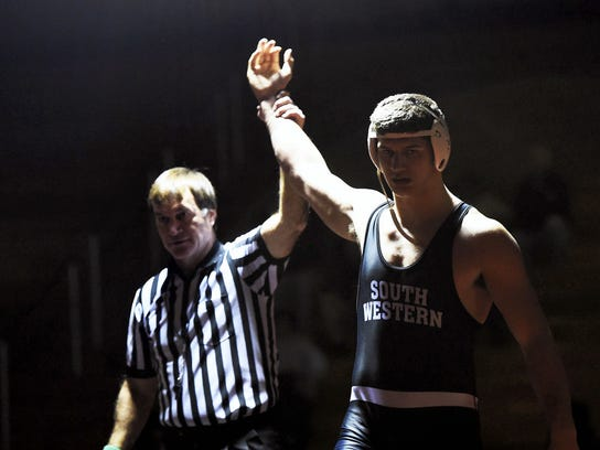 South Western's Seth Janney won his match against Kennard-Dale's Tanner Harkins on Dec. 17, 2014. Clare Becker - The Evening Sun
