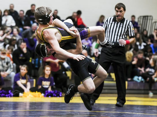 Delone's Antonio Ugarte brings down Boiling Springs' Caleb Holley in the 120-weight class bout during the quarterfinal match Wednesday Jan. 28, 2015 in the District 3 team wrestling tournament. Delone lost 50-12 in the match against Boiling Springs.  Shane Dunlap - GameTimePA.com