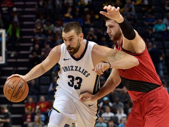 Memphis Grizzlies center Marc Gasol (33) drives against Portland Trail Blazers center Jusuf Nurkic in the first half of an NBA basketball game Wednesday, March 28, 2018, in Memphis, Tenn. (AP Photo/Brandon Dill)