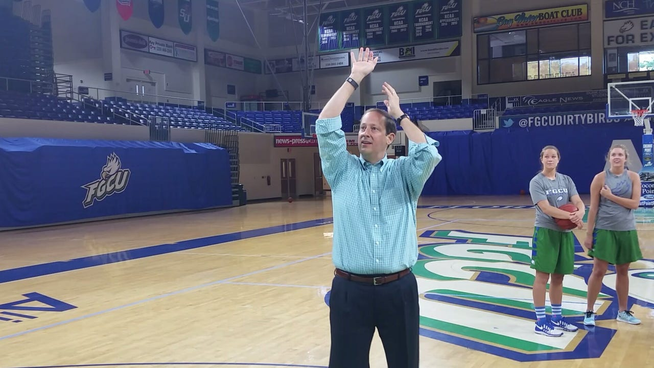 Sen. Joe Negron shows Florida Gulf Coast University forward Marc-Eddy Norelia that he can nail a jumper from three-point range.