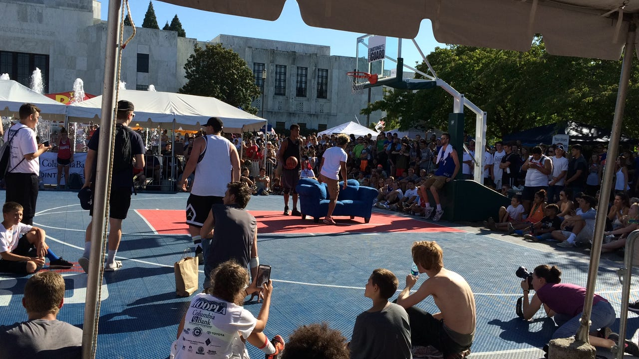 Isaiah Edwards jumps over a friend on a couch Saturday to win the annual dunk contest at Hoopla.