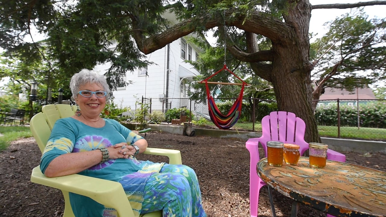 Susan Craver discovered a large honey beehive after a recent storm broke off the top of her tree on Linden Avenue. With the help of Ron Gilbert, a Dover Township beekeeper, the city hive has become part of her urban paradise.