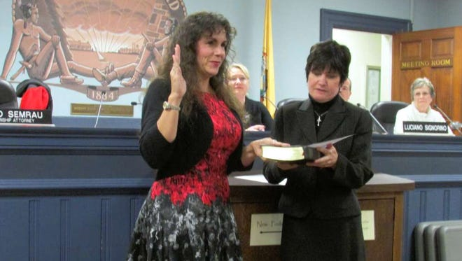 Township of West Milford Administrator Antoinette Battaglia administers an oath of office to Bettina Bieri, who is now in her 11th year as township mayor.