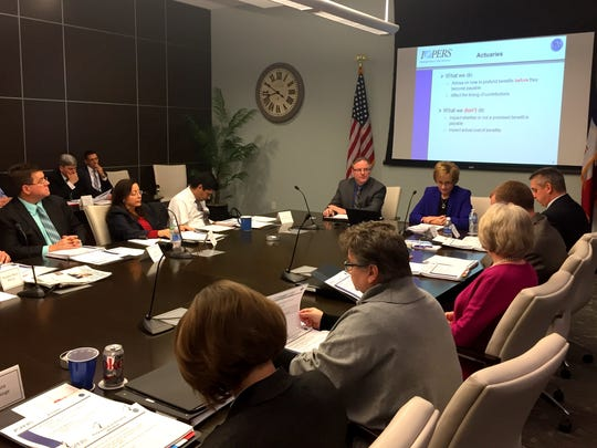 The Iowa Public Employees' Retirement System's Investment Board is shown meeting on Dec. 1, 2016, with its actuarial consultants in Des Moines.